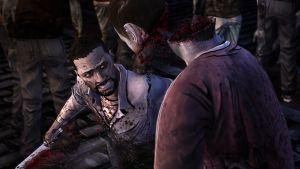 twd-ep-5-screenshot-lee-cuts-zombie-head-in-two.jpg